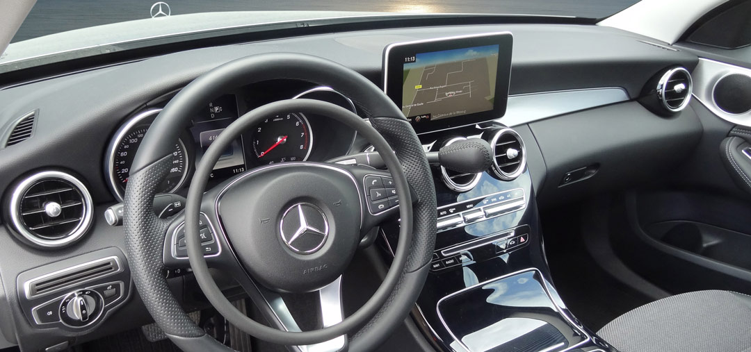 Mercedes C-Class with digital hand controls Darios and hand brake by Kempf