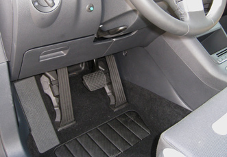 Electronic left foot gas pedal